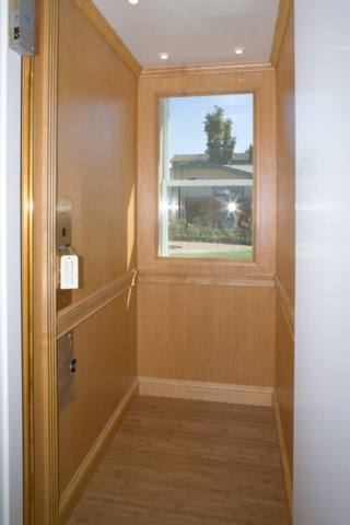 Accessible home remodel featuring elevator with window.