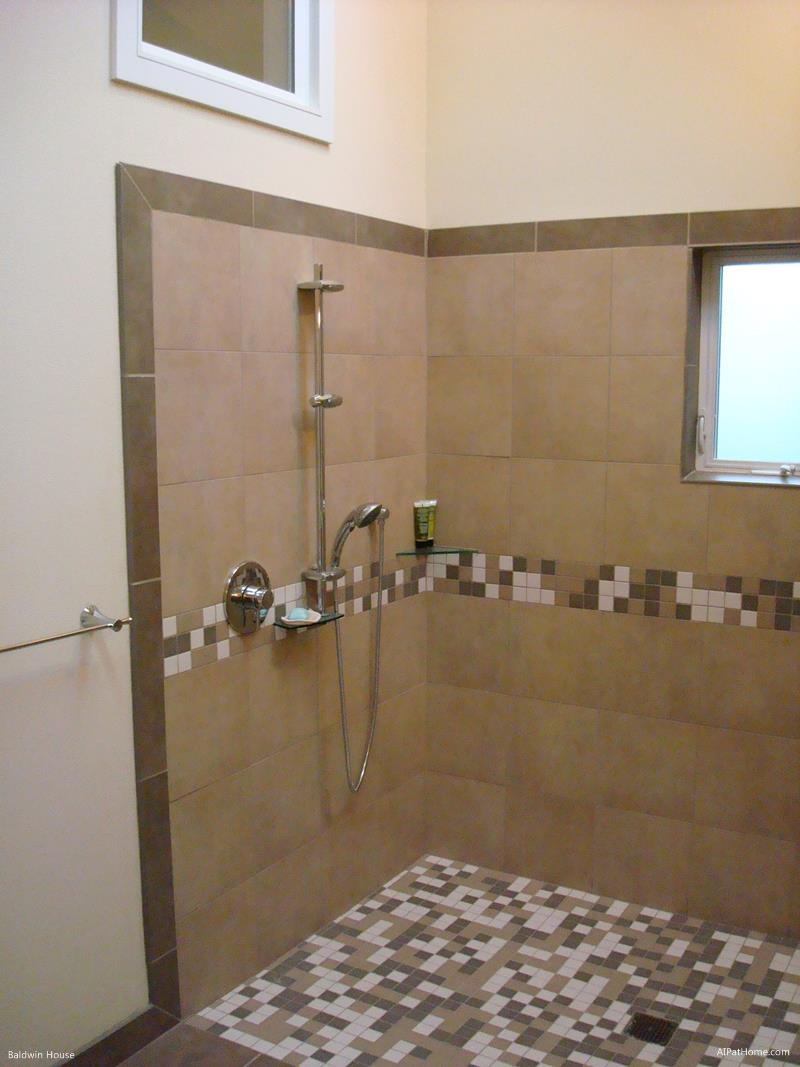 Baldwin House Bathroom curbless shower with offset controls for caregivers.